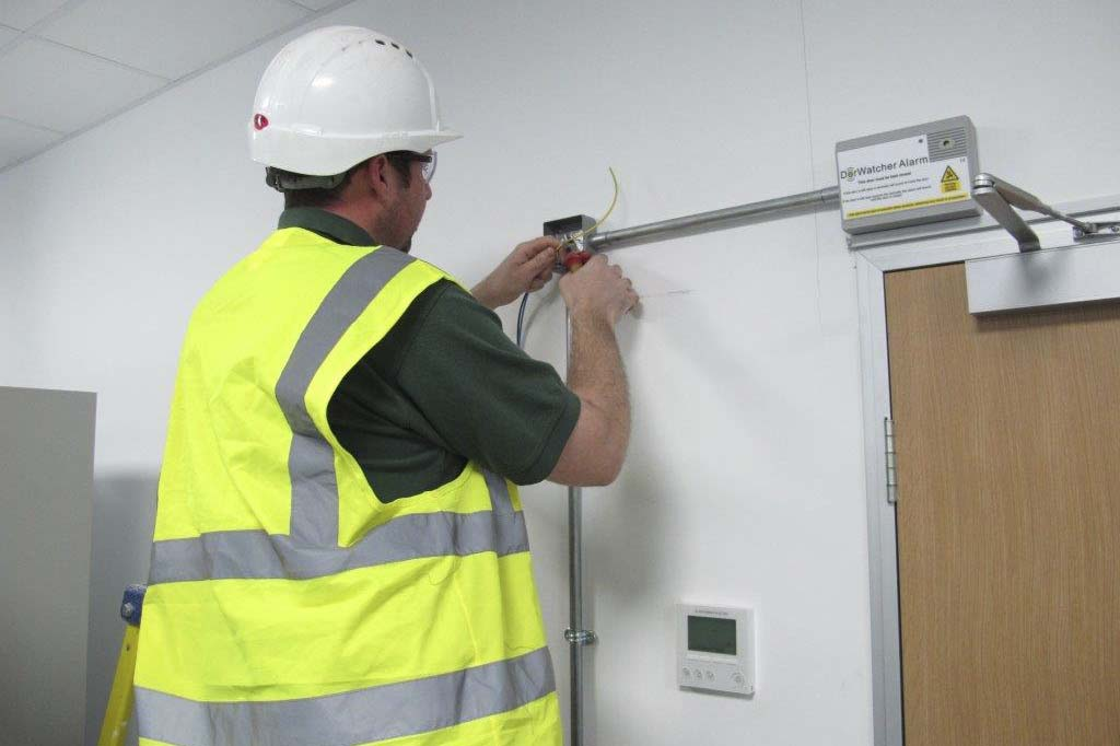 Man installing electrical cables into conduit